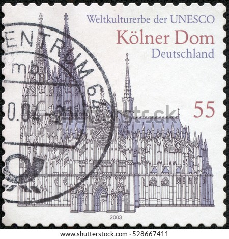 CHONGQING, CHINA - May 10, 2014:a stamp printed in the Germany shows Cologne Cathedral, UNESCO World Heritage Site, circa 2003
