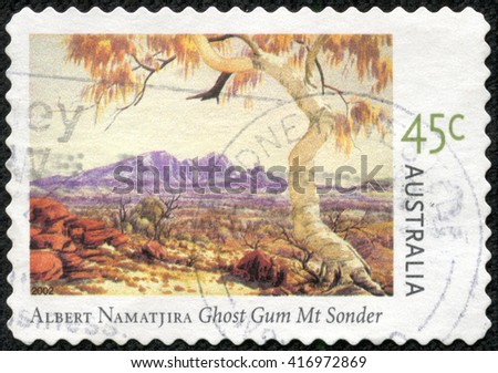CHONGQING, CHINA - May 9, 2014:stamp printed by Australia, shows Paintings by Albert Namatjira, circa 2002 - stock photo