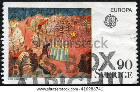 CHONGQING, CHINA - May 9, 2014:stamp printed by Sweden, shows New Year's Eve at Skansen by Eric Hallstrom, circa 1975 - stock photo