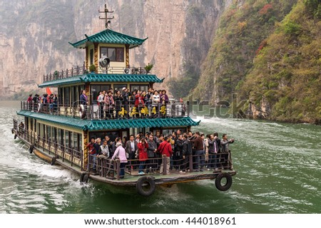 Chongqing, China, 19 Nov 2012: Crowded cruise ship with tourists sailing along Three Gorges,