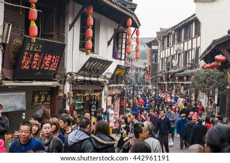 Chongqing, China, 21 Nov 2012: Huge crowd in ancient city of Ciqikou with historical shophouses.
