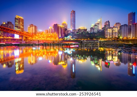 Chongqing, China riverside cityscape at night on the Jialing River.