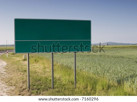 Choose your way - billboard in field - stock photo