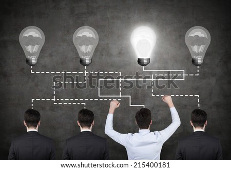 Choosing a potential employee. Correlation between four light bulbs and four employees. - stock photo