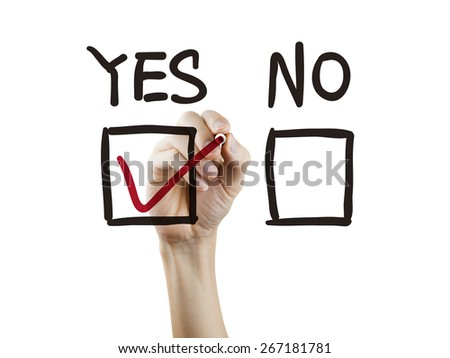 choosing yes on survey by hand over white background - stock photo