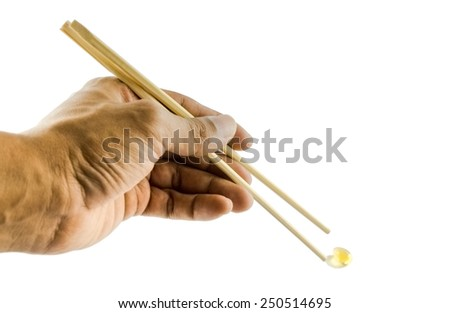 Chop stick picking a fish oil - stock photo