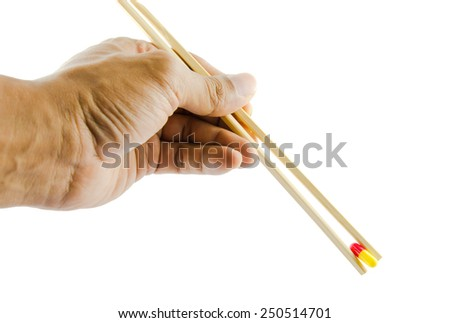 Chop stick picking a medicine - stock photo