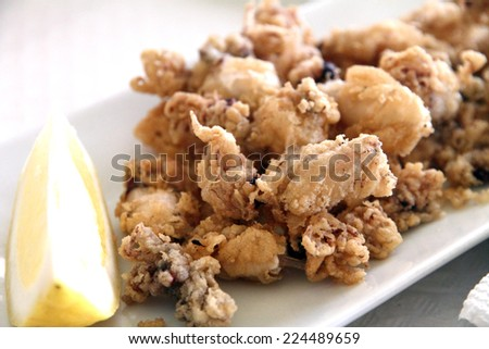 Chopitos are a fried little squids Spain Valencia - stock photo