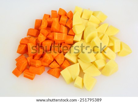 Chopped and sliced carrot and potatoes  - stock photo