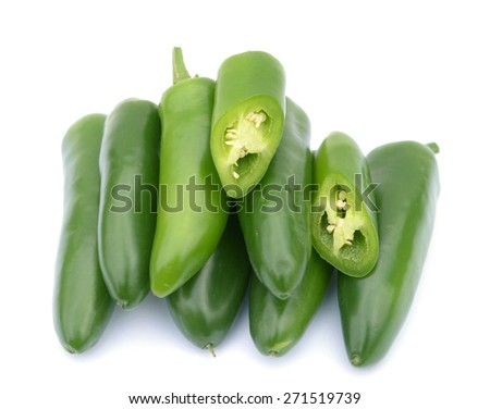 chopped and whole  green jalapeno peppers on white background  - stock photo