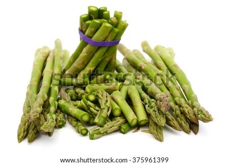 chopped asparagus on white background  - stock photo