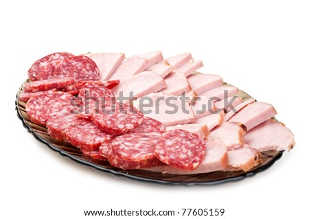 chopped bacon and salami on a plate isolated on a white background - stock photo