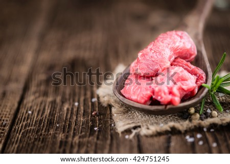 Chopped Beef Steak on wooden background (selective focus; close-up shot) - stock photo