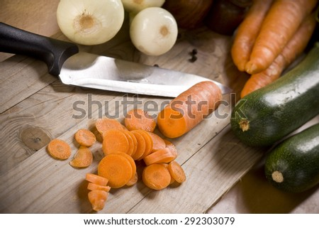 Chopped carrot on the kitchen table - stock photo