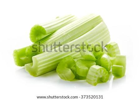 chopped celery sticks isolated on white background - stock photo