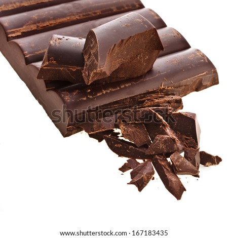 Chopped chocolate bar and cocoa beans isolated on white background