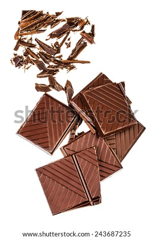 Chopped chocolate bar isolated on white background. Dark chocolate pieces closeup. Chocolate pieces, studio image. - stock photo