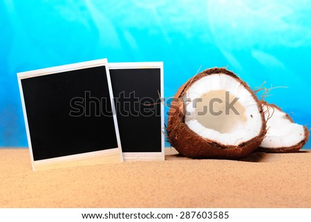 chopped coconut and photoframe on the sand - stock photo
