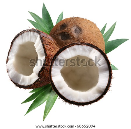 Chopped coconuts with leaves on white background. File contains a clipping paths. - stock photo