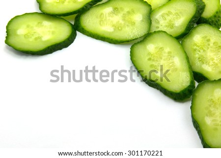 chopped cucumber rings isolated on white background