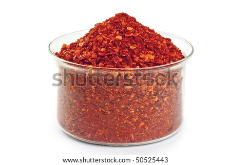 Chopped dry paprika in glass bowl - stock photo