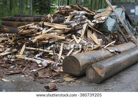 chopped firewood and logs - stock photo