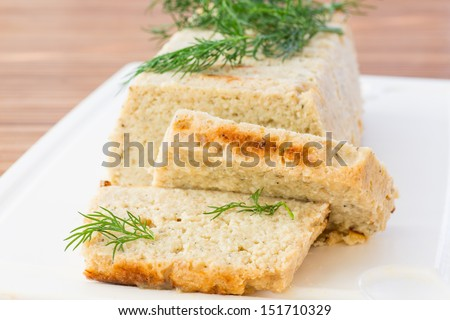 chopped fish souffle  with dill on table