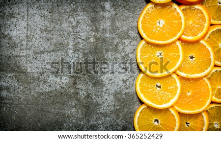 Chopped fresh oranges .On the stone table. Top view.  Free space for text . Top view - stock photo