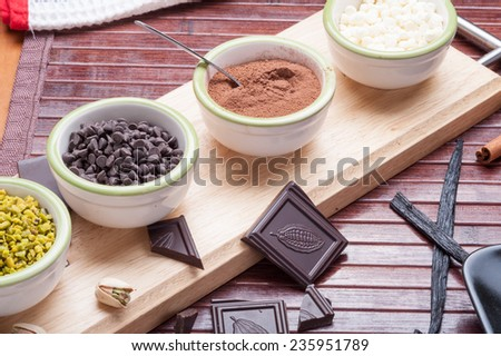 chopped ingredients for sweets in a cup - stock photo