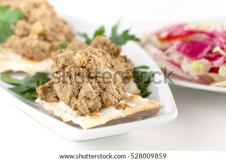 Chopped liver and onions served with cabbage salad