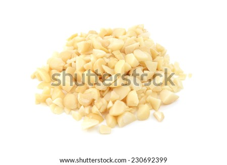 Chopped macadamia nuts, isolated on a white background - stock photo