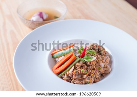 Chopped mackerel fry with chili and herb, with vegetables and Thai rice. - stock photo