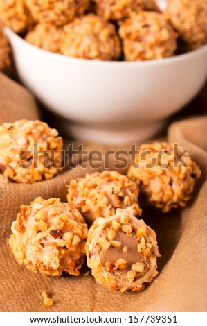 Chopped nuts and sweet cream in praline. Selective focus on the sliced praline