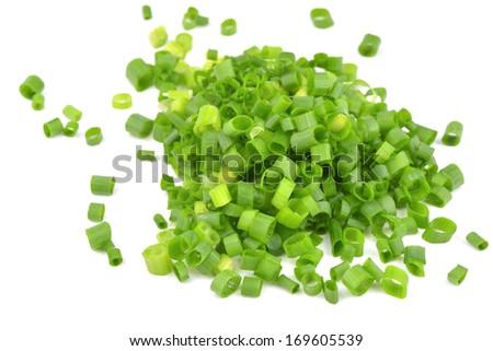 chopped of Fresh scallions isolated on a white background - stock photo