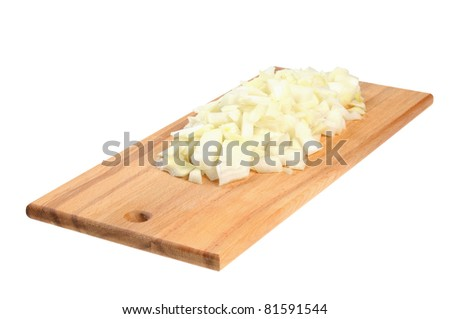 Chopped onions on a wooden board. Isolated on white.