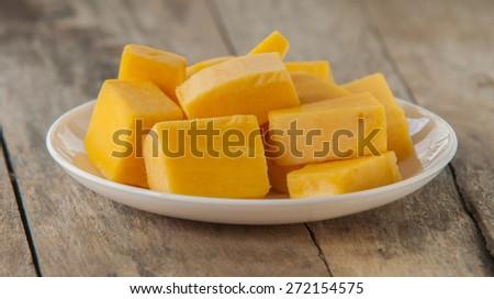 Chopped orange butternut squash on cutting board/Diced Squash - stock photo