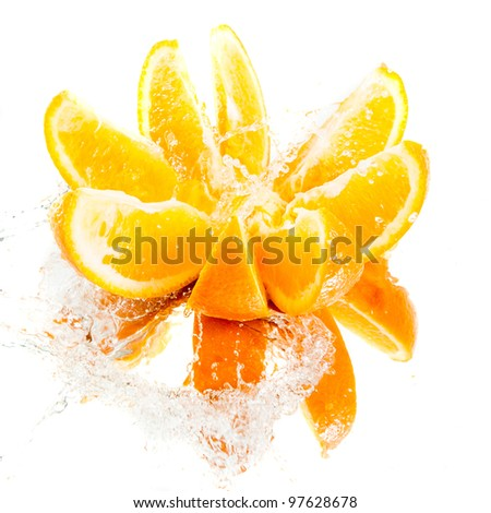 Chopped orange in water splash - stock photo
