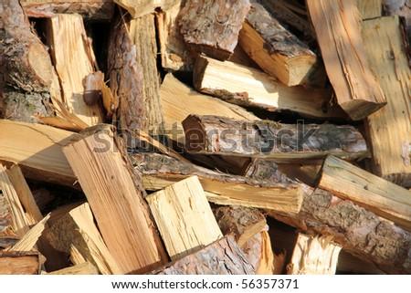 Chopped pine fire wood background - stock photo