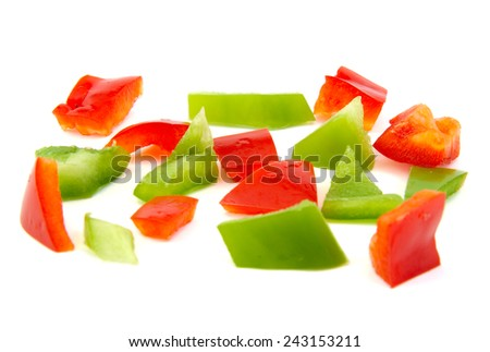 Chopped red and green pepper on white background - stock photo