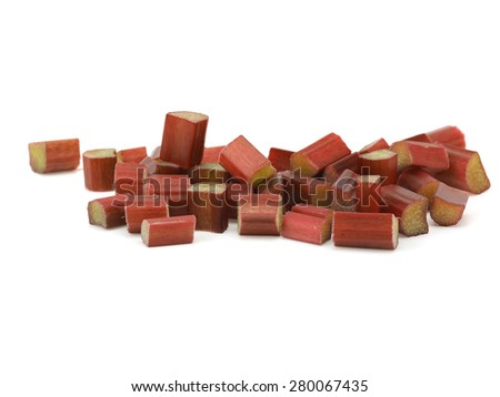 Chopped rhubarb stalks on a white background - stock photo