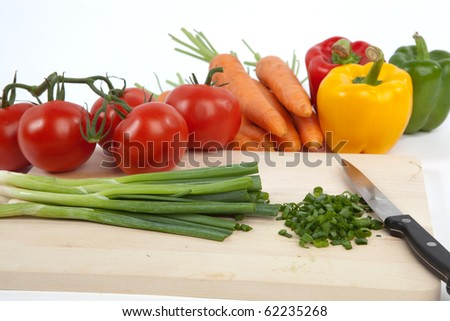 Chopped Spring Onion Tomatoes Carrots and Paprika on White Isolated Background - stock photo