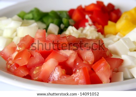 Chopped tomatoes, capsicums, mozarella, onions, garlic, Italian cooking ingredients