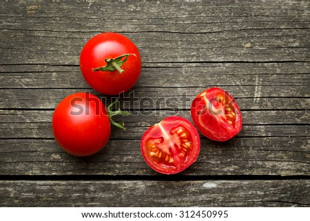 chopped tomatoes on old wooden table - stock photo