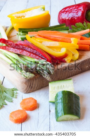 Chopped vegetables on cutting board - stock photo