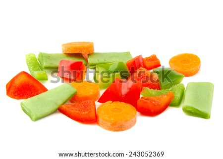 Chopped vegetables. Red and green pepper, carrot and beans on white background. - stock photo