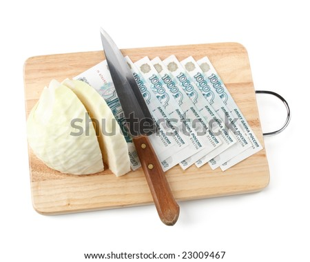 Chopping board, cash, knife and cabbage. Money concept.