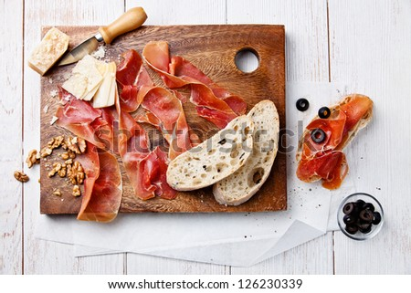 Chopping board of Cured Meat, Cheese and Olive - stock photo
