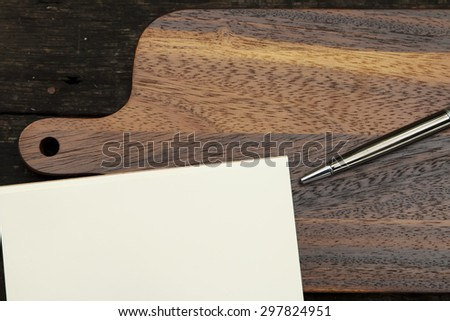 Chopping board wood and paper for note or background.