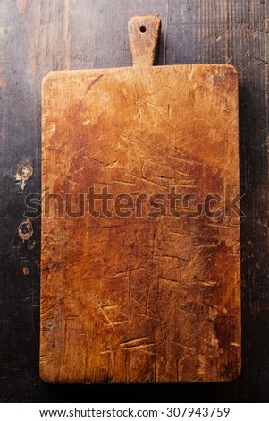 Chopping cutting board block on wooden texture background - stock photo