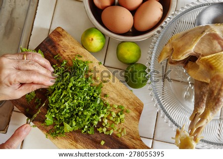Chopping parsley for cooking ingredient in the next step - stock photo